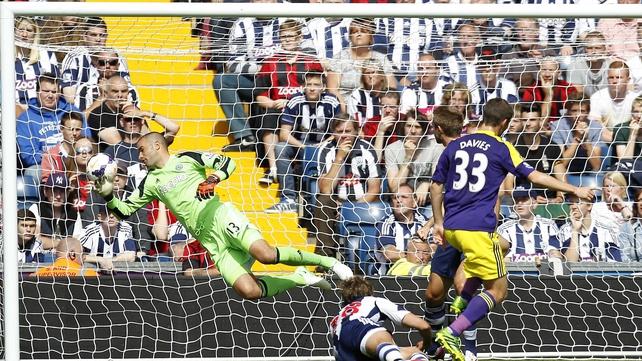 Swansea City's Ben Davies (R) scores past West Brom goalkeeper Boaz Myhill