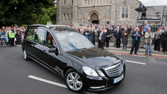The hearse departs the Dublin church for the final journey to Co Derry