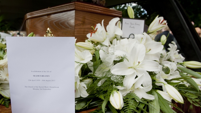 Family flowers on the coffin of Seamus Heaney