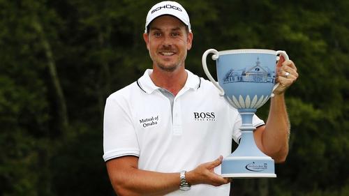Henrik Stenson wins the winner's trophy after his success in Boston