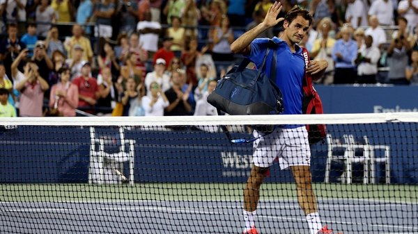 Roger Federer waves goodbye to the Louis Armstrong crowd after his loss to the 19th seed Tommy Robredo