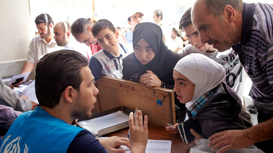 A family of Syrian refugees register for protection and other social services at the UNHCR offices in the Zamalek neighbourhood in Cairo (Pic: UNHCR/S Baldwin)
