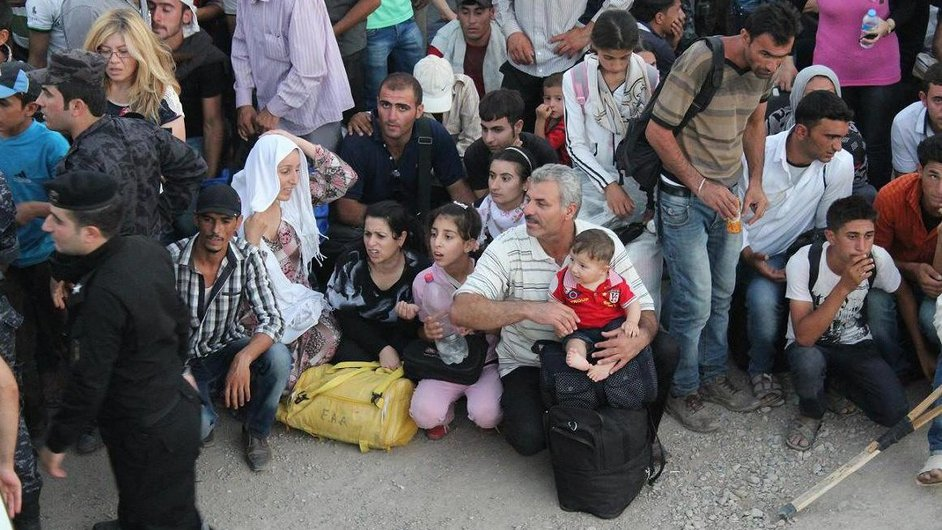 Refugees leave Syria for Iraq through the Peshkhabour border crossing in Dohuk last month (Pic: UNHCR/G Gubaeva)