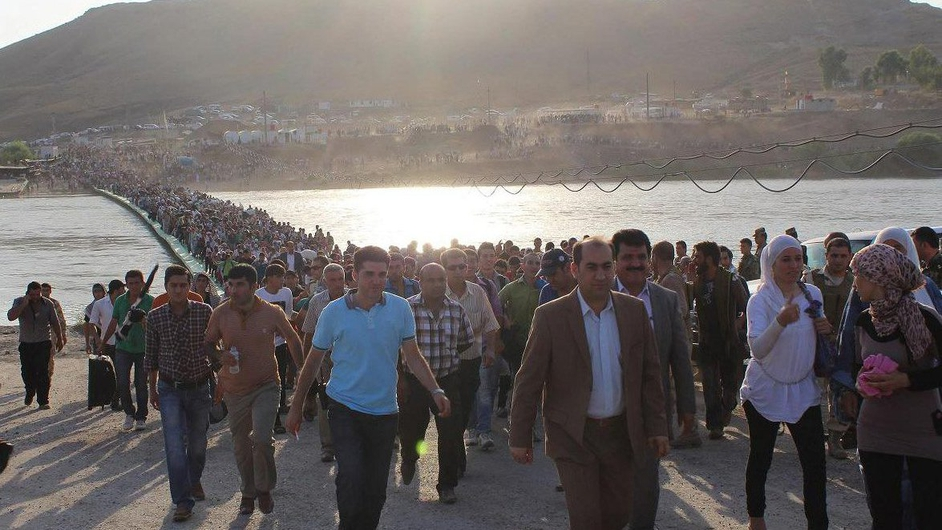 Hundreds of Syrians crossed into Iraq at the Peshkhabour border crossing in Dohuk on 15 August (Pic: UNHCR/G Gubaeva)
