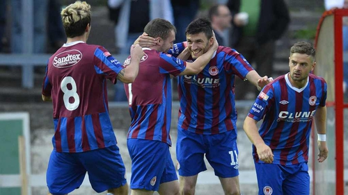 Killian Brennan celebrates with team-mates in Derry