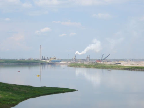 Tailings pond and industry in the distance