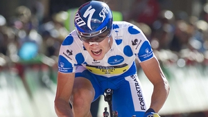 Nicolas Roche remains within touching distance of the overall lead