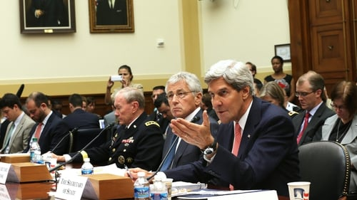 Vladimir Putin accused John Kerry (foreground) of lying to the US Congress