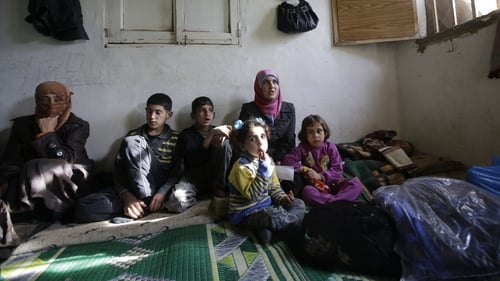 A Syrian refugee family pictured in their accommodation in the Lebanese city of Tripoli