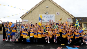 4th class students from St Finnachta's National School, Sixmilebridge, Co Clare cheer on the Banner