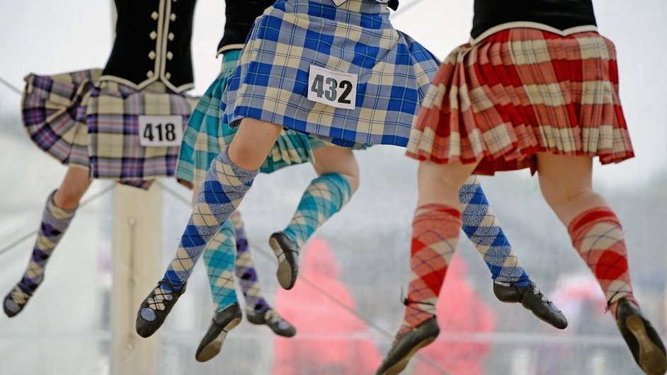 Highland dancers perform the Real of Tulloch during competition at the Cowal Highland Gathering