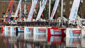 Sailors prepare their boats to depart from St Katharine Docks for the start of the 'Clipper 2013-14 Round the World Yacht Race'