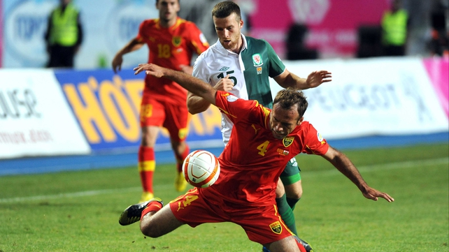 Macedonia's Nikolche Noveski (Front) vies for the ball with Wales's Adam Matthews