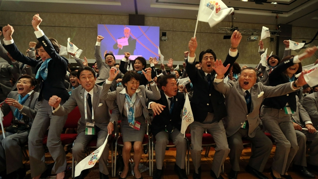 The Japanese bid team celebrates winning the rights to host the 2020 Olympic Games