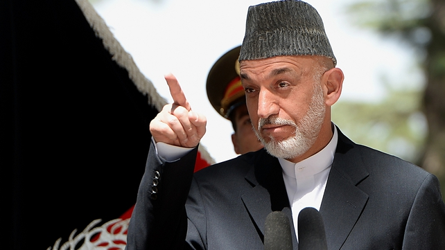 Hamid Karzai has banned Afghan troops from calling for foreign air strikes