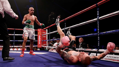 Raymundo Beltran knocks Ricky Burns to the canvas in Glasgow