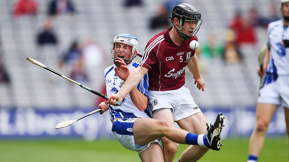 Michael Harney of Waterford takes a heavy tackle from Galway's Sean Linnane.