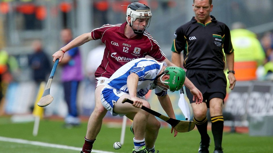 Cian Leamy Waterford and Adrian Morrissey Galway tussle for possession.