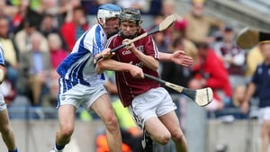 Galway's Brian Molloy breaks the tackle of Michael Harney of Waterford.