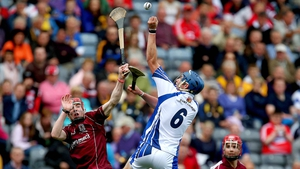 Austin Gleeson of Waterford and Conor Whelan of Galway contest a high ball.
