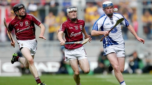 Stephen Bennett of Waterford escapes the attention of Conor Shaughnessy and Vincent Doyle of Galway.