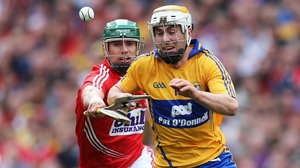 Clare's Conor McGrath tries to evade the attention of Brian Murphy