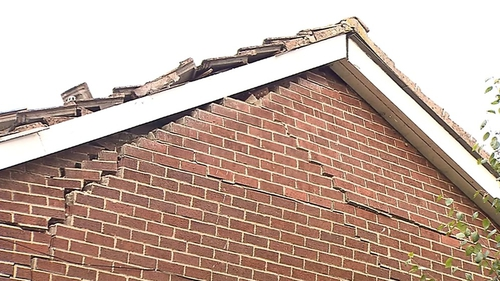 A gable wall of the complex was damaged in the explosion