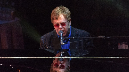 Elton John has praised One Direction for their strong work ethic
