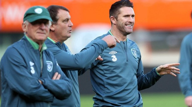 Robbie Keane and the Republic of Ireland management team pictured in relaxed mood at the Ernst Happel Stadium in Vienna on Monday