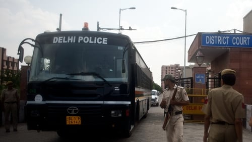 A police vehicle believed to be carrying the four men leaves the Saket District Court