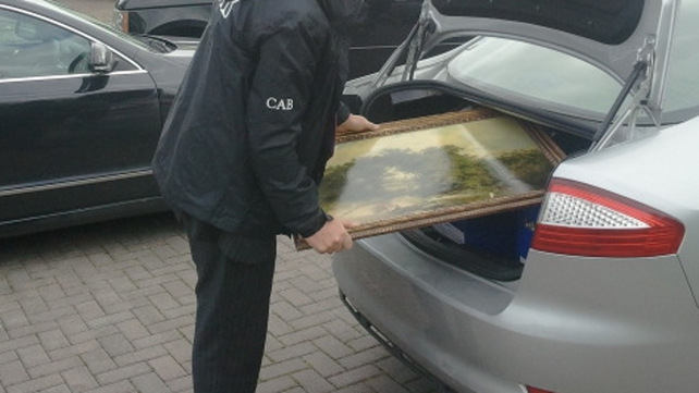 Artefacts, cash and documents were seized in raids carried out by CAB in Limerick