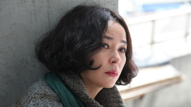 Jo Min-Soo as the mysterious Mi-Son comes to stay with her supposed son, a psychopathic debt collector