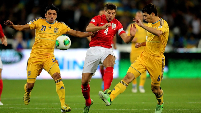 (L to R) Edmar, Steven Gerrard and Taras Stepanenko clash