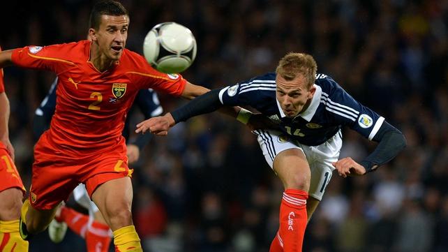 Jordan Rhodes of Scotland gets there ahead of Macedonia's Daniel Georgievski
