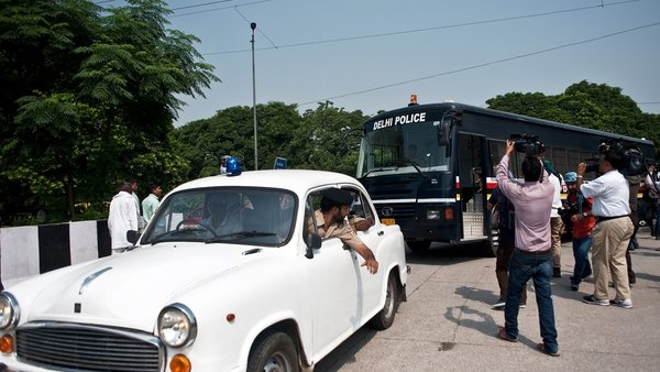 A van believed to be carrying the four men arrives at the Saket Court Complex in New Delhi