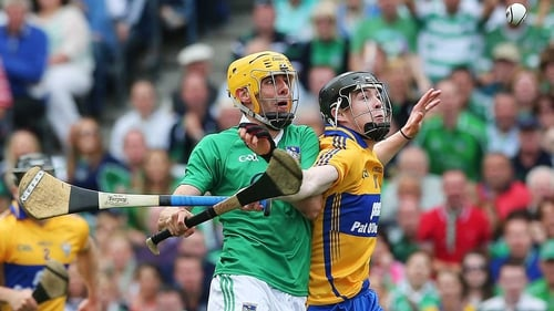 Tony Kelly keeps tabs on Limerick's David Breen in the All-Ireland semi-final