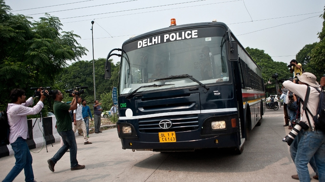 Indian police van believed to be carrying the accused in the case, arrives at the Saket Court Complex in New Delhi