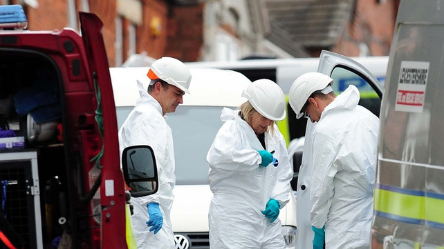 Forensic teams prepare to examine the scene