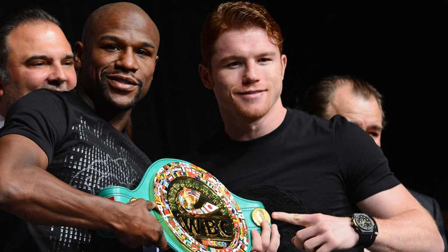 Floyd Mayweather and Saul Alvarez i at the pre-fight weigh-in
