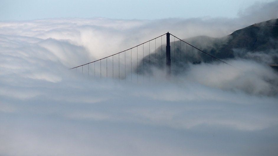 The north tower of the Golden Gate Bridge in San Francisco is surrounded by fog