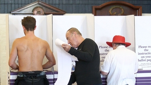 Voters casts their ballots in a polling station on Bondi Beach in Australia's general election