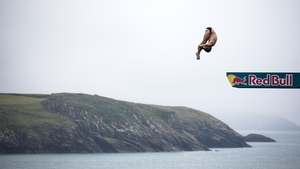 Mat Cowen of the UK dives from the 27-metre platform during the Red Bull Cliff Diving World Series at St David's in Wales