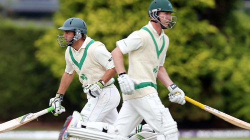 Andrew White and John Anderson making runs as Ireland are close to victory in this ICC clash