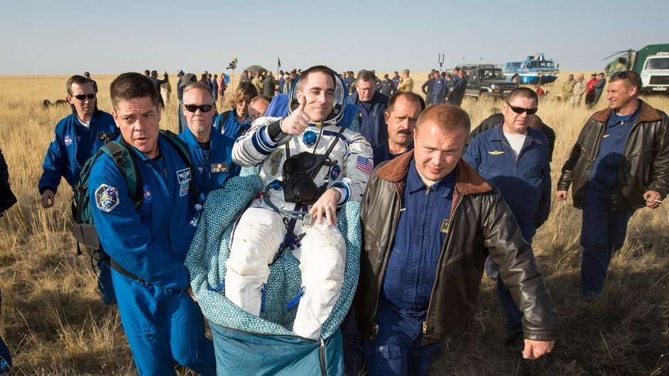 Flight Engineer Chris Cassidy is carried to the medical tent shortly after he and his two Russian colleagues returned to Earth after five-and-a-half months on the International Space Station