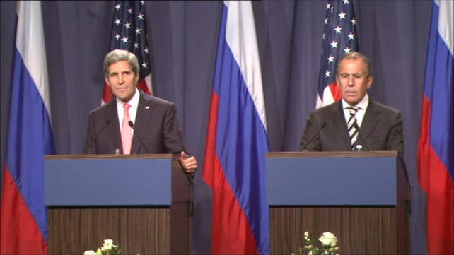 John Kerry (L) and Sergei Lavrov (R) said if Syria does not comply with the agreement it would face consequences under Chapter 7 of the UN Charter