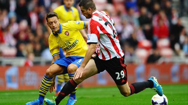 New Arsenal signing Mesut Oezil takes on Sunderland's Valentin Roberge