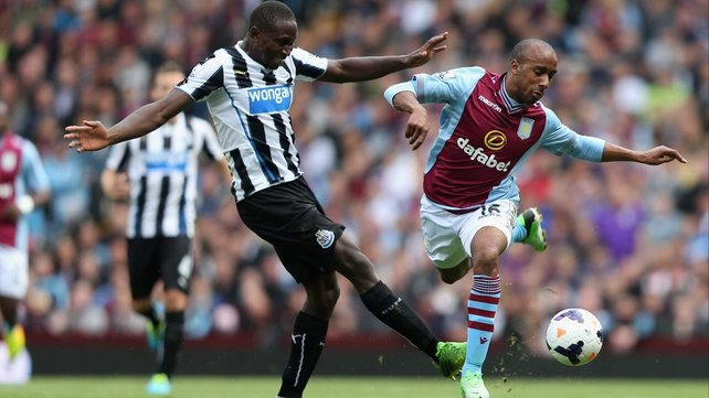 Fabian Delph of Aston Villa tangles with Newcastle's Mapou Yanga-Mbiwa
