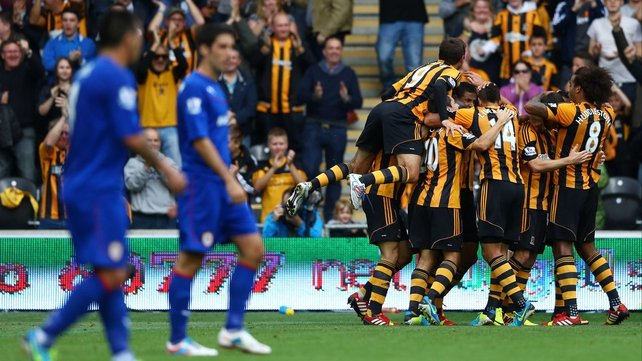 Hull City players mob goal scorer Curtis Davies at the KC Stadium