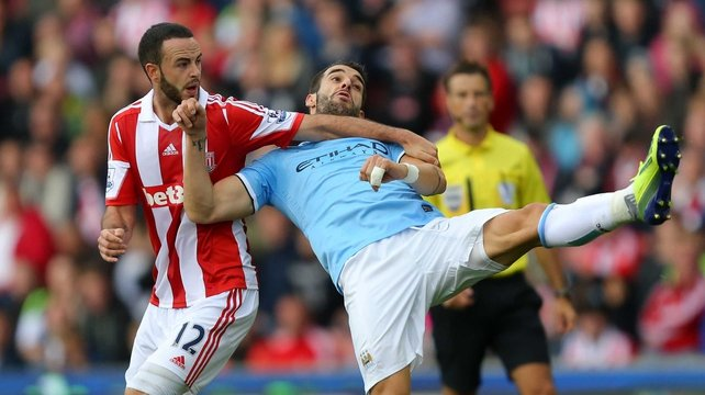 Stoke City's Marc Wilson (l) tussles with Alvaro Negredo