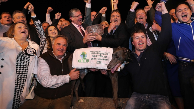 Slippery Robert with trainer Robert Gleeson (r) after winning the Irish Greyhound Derby at Shelbourne Park